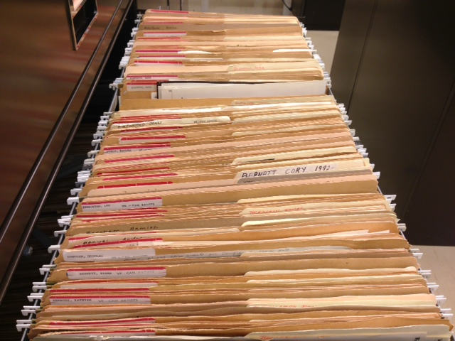 Canadian artist files showing one drawer open with contents.