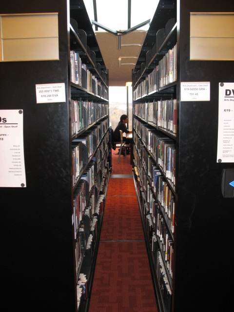 DVD compact shelving partially opened as seen on the 5th floor of the Toronto Reference Library
