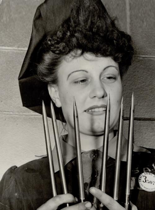 1942 photo: Dorothy Hyslop, Toronto, inspecting bayonets
