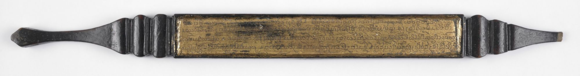 Wooden title indicator covered with black lacquer, and text incised in Tham script on gold background. Lanna, 19th century. British Library, Or.16555. Acquired from Dr Henry Ginsburg's bequest, in memory of Dr Henry Ginsburg.