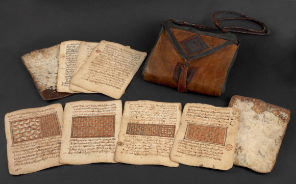 Qur'an typical of the artistic tradition of northern Nigeria/southern Niger. The manuscript is late 18th/19th century and is divided into four by the large illuminations shown here. It is loose leaf and kept in a leather bag, as was usual for West African manuscripts. British Library, Or. 16751