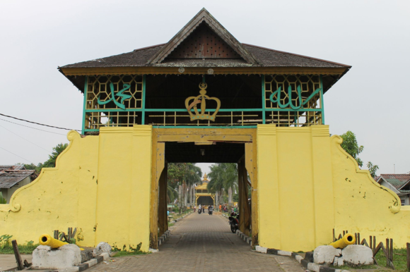 Entrance archway to the palace of Pontianak, Istana Kadriah, painted in yellow, the Malay colour of royalty. Photograph by A. Gallop, September 2015.