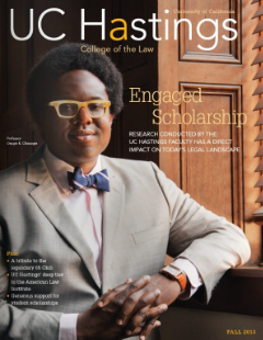 A cover of UC Hastings' alumni magazine features law professor Osagie Obasogie, who stands next to a window