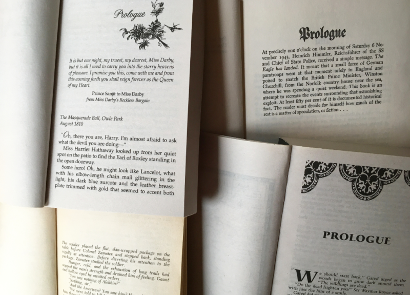Various books open to the prologue page