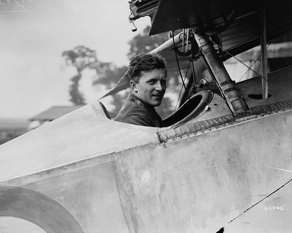 Billy Bishop in cockpit of plane looking at camera